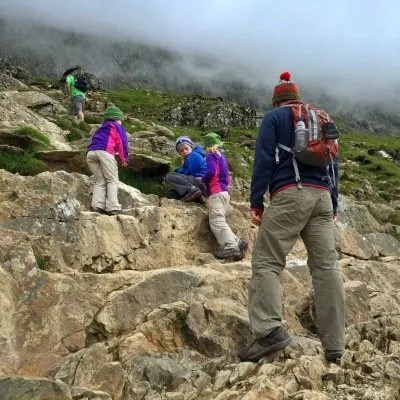 kids climbing to the top of mount snowdon