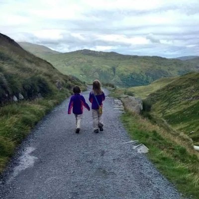 two little girls hiking on trail
