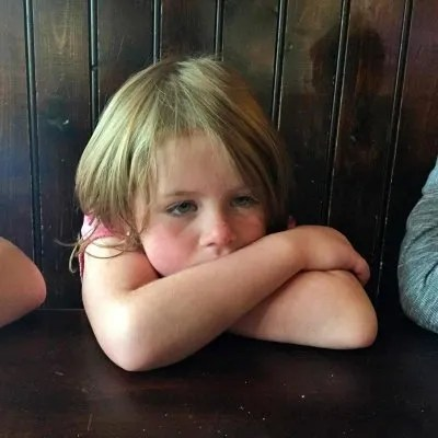 little girl looking sleepy