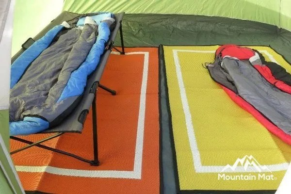 orange and yellow tent mats with cots