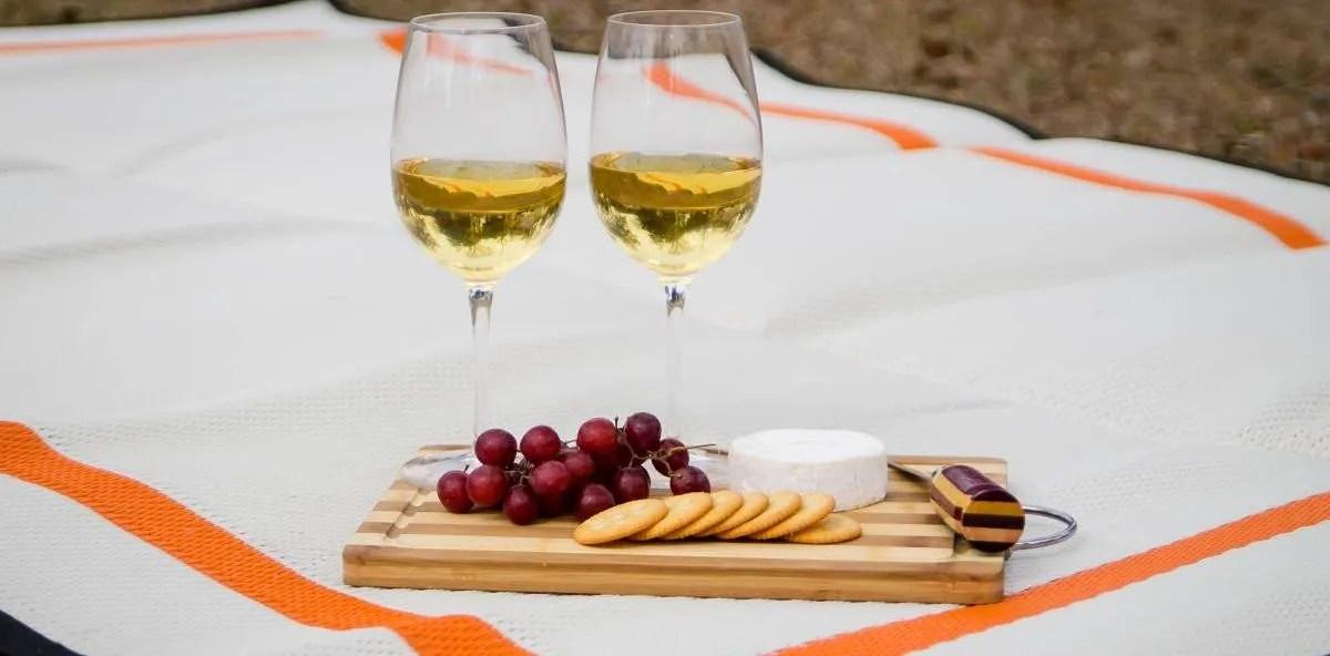 wine and picnic on white orange reversible picnic blanket