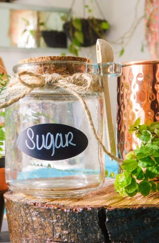 Glass chalkboard label sugar and spice jar with twine and wooden spoon