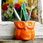 Stained glass aloe plant in orange owl planter