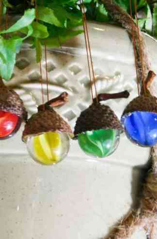 Four hanging vintage marble ornaments with natural acorn caps