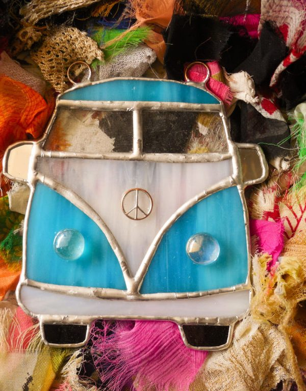 Aqua Blue VW Bus Suncatcher on a rag rug