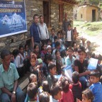 rajendra-nhisutu-and-himet-volunteers-with-children-after-distribution-books-and-stationary-144x144