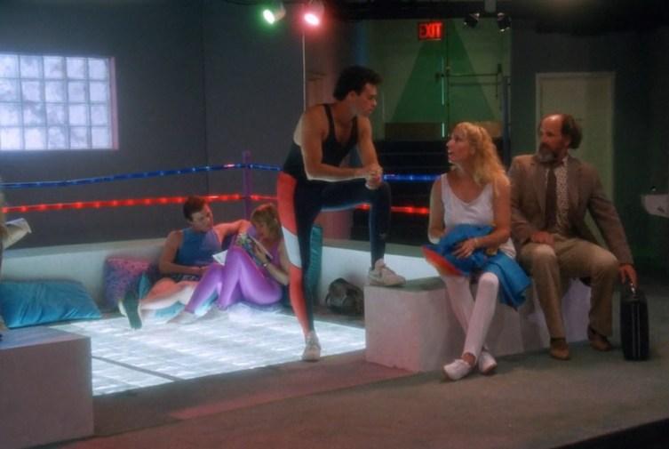 Blending in with the regulars at the bottom-lit crystal makeshift wrestling ring?