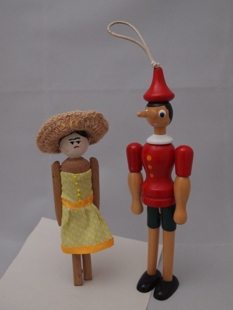 Peggy and Gino, a pair of wooden dolls.