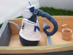 Ernest poses in the rowing boat in his sailor suit.