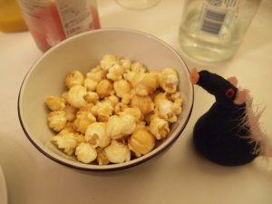 Fury looks at a bowl of popcorn