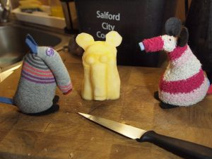 Matilda has carved a likeness of Dim out of the piece of swede.