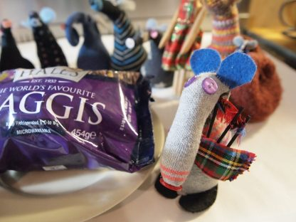 Dim plays the bagpipes to the haggis