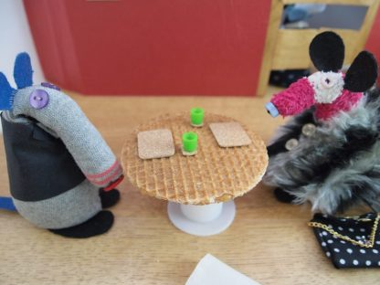 Dim and Matilda look at their caramel waffle tabletop