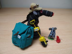 Bernard wears a pith helmet and the full rucksack, and Microvaark has a tiny spotted hankie bundle tied to a stick.