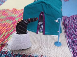 Microvaark comes out of the tent to find Bernard wearing a towel round his waist and a little shower set up