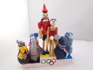 Peggy, Gino, Arnold, Ernest Dim and Vincent are on the podium with their medals