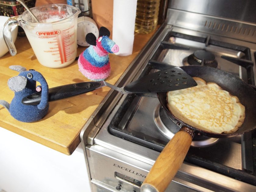 Ernest and Ratvaark cook another pancake using a spatula to flip it