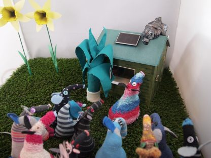 All the vaarks are looking at the dragon on the shed roof