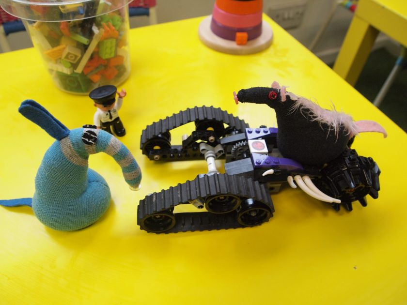 Fury sits on a lego vehicle - a tricycle with caterpillar tracks