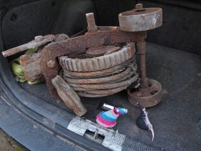 Ratvaark shows Fury a very rusty old winch in the boot of the car