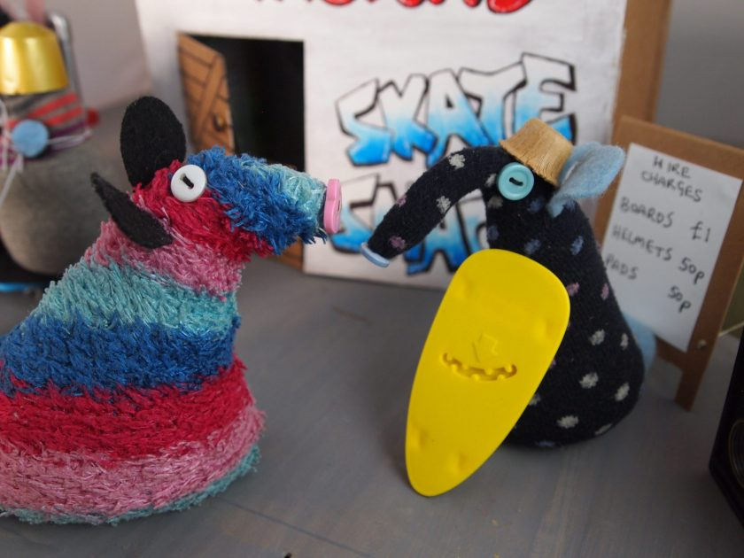 Winston shows Ratvaark a board that is much wider at one end.