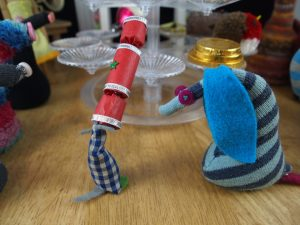 Microvaark has his snozzle jammed into the end of a mini cracker