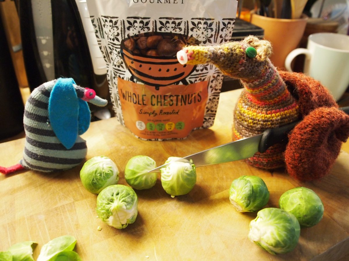 Esther and Ofelia prepare some sprouts, and a packet of chestnuts