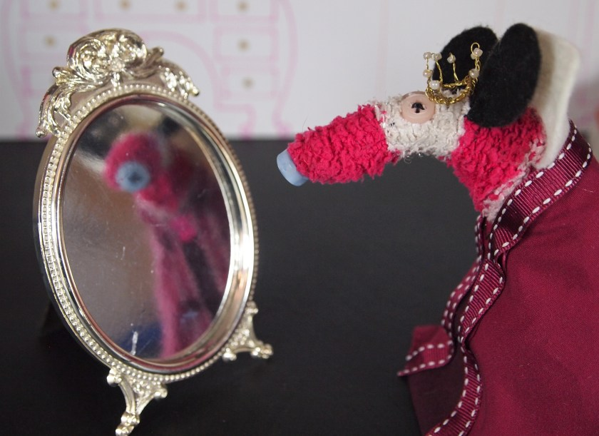 The queen speaks to the mirror