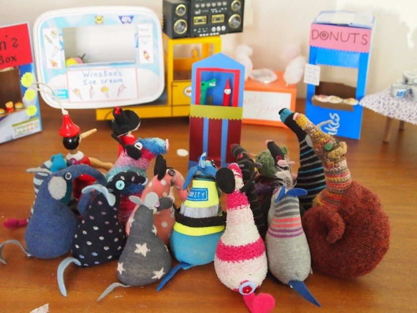 all the vaarks gather round to watch the punch and judy show