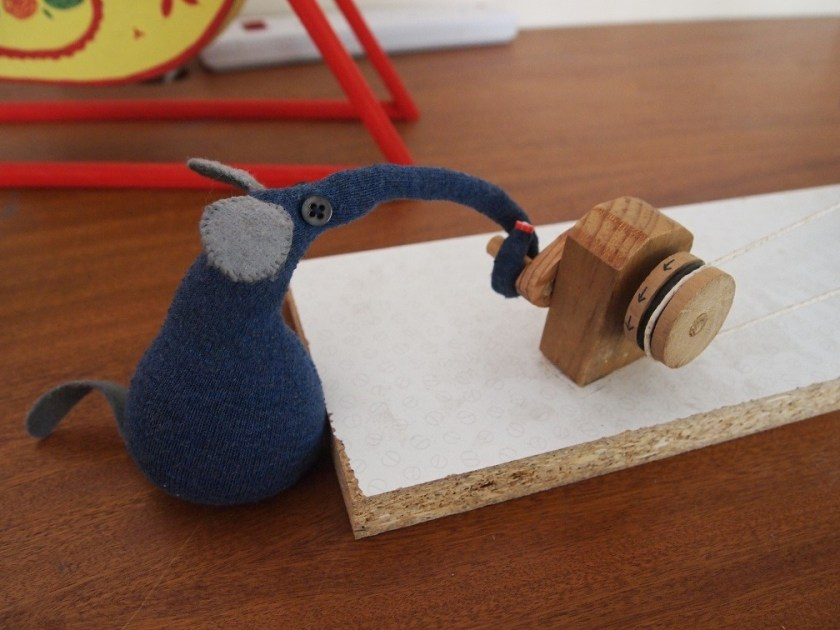 ernest turns a wooden handle