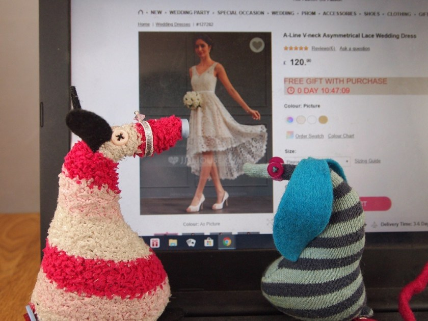 Ofelia and Matilda look at a short dress with a floaty lacy skirt