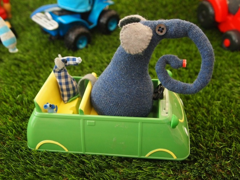 Ernest drives a little car with Micro and Nano in the back