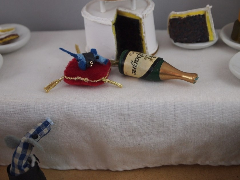 Nano appears to have drunk all the champagne and fallen asleep on the red velvet ring cushion