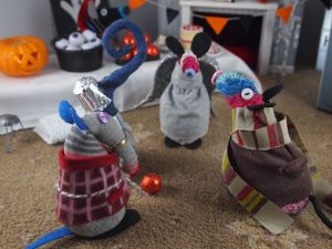 Ratvaark and Ernest are starled by Matilda who is wearing a grey robe and sparkly silver wings