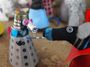 Hypno looks at the Dalek's eye, which matches his