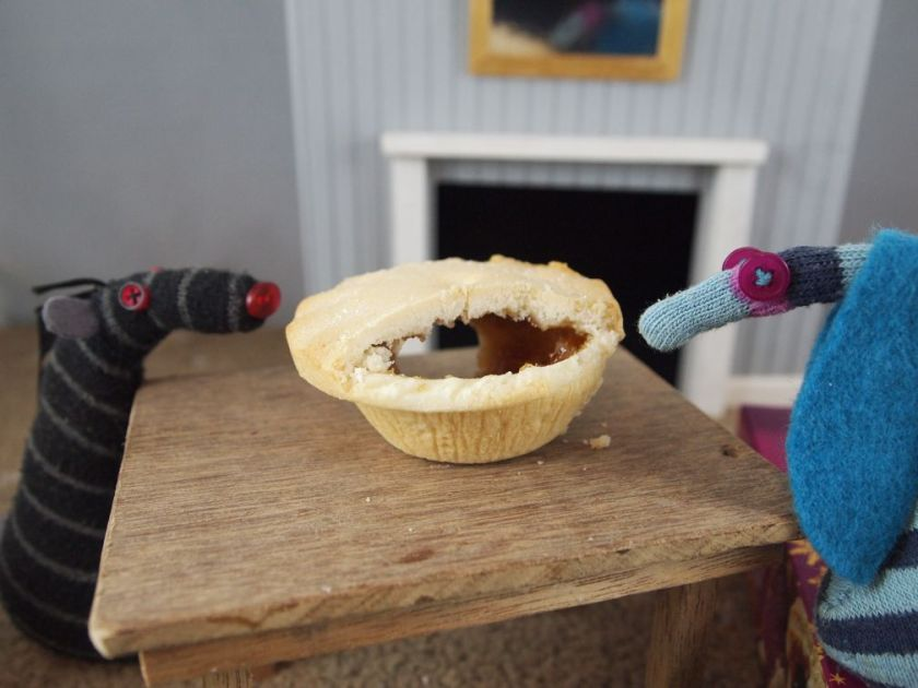 Bernard looks round the back of the pie where there is a hole cut in the pastry