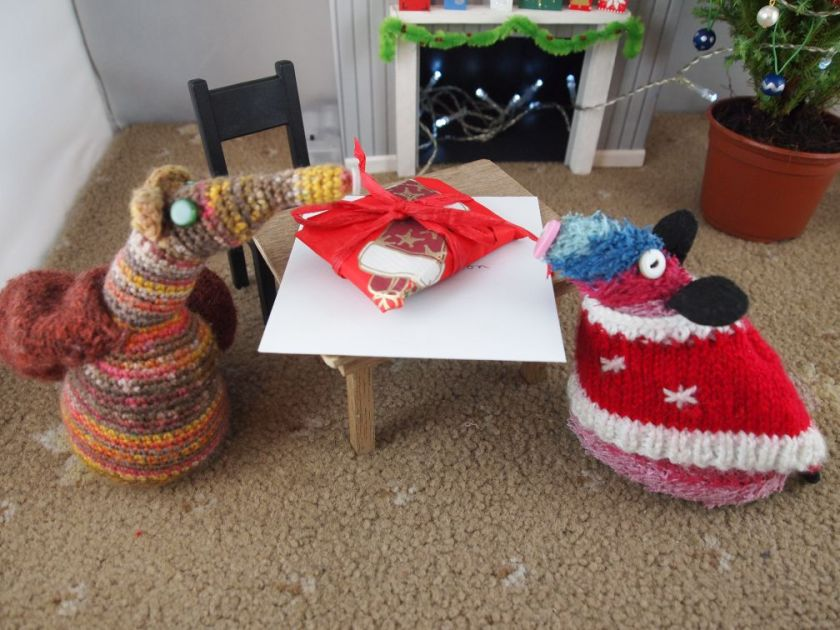 Esther and ratvaark look at the finished parcel