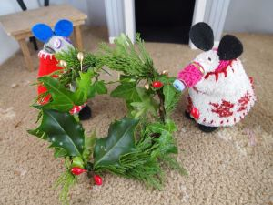 Dim and Matilda add some berries on wire to the wreath