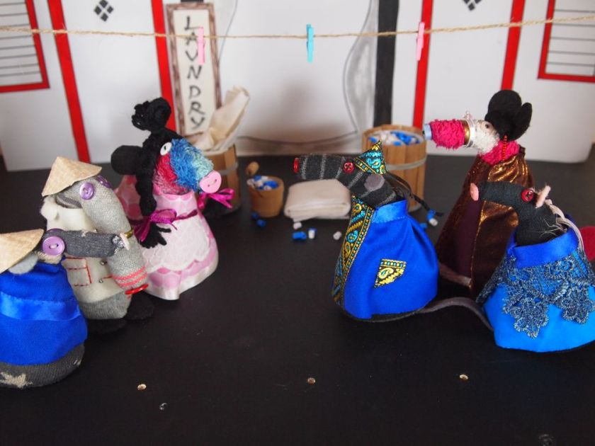 Aladdin, the widow and wishee watch as bernard as the emperor, matilda as jasmine and fury as so-shi parade in