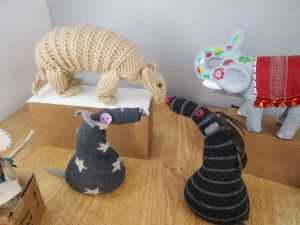 vincent and bernard look at a knitted armadillo