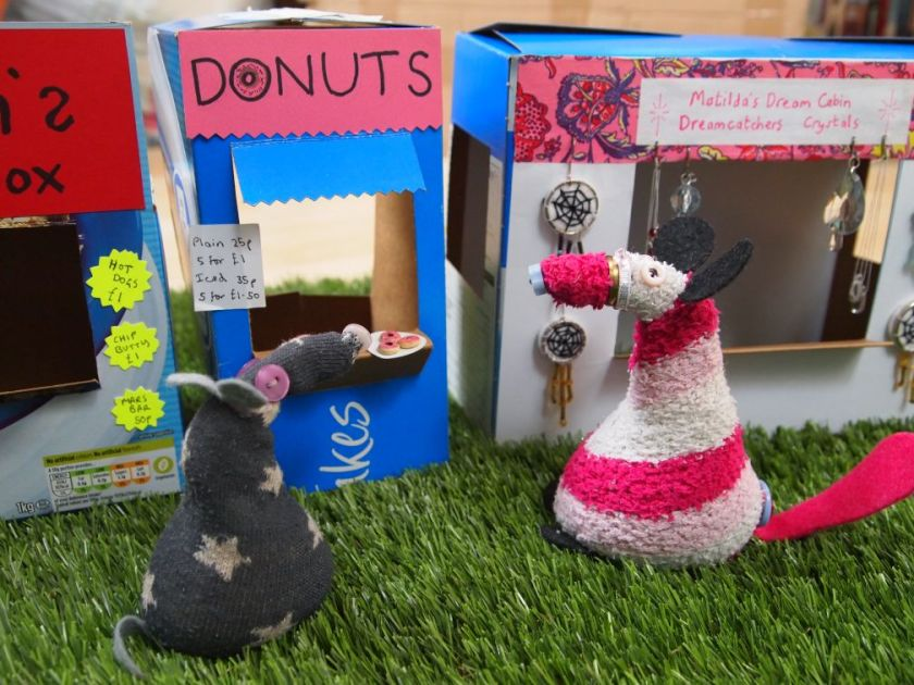 Matilda talks to Vincent, her stall is next to his doughnut stand.