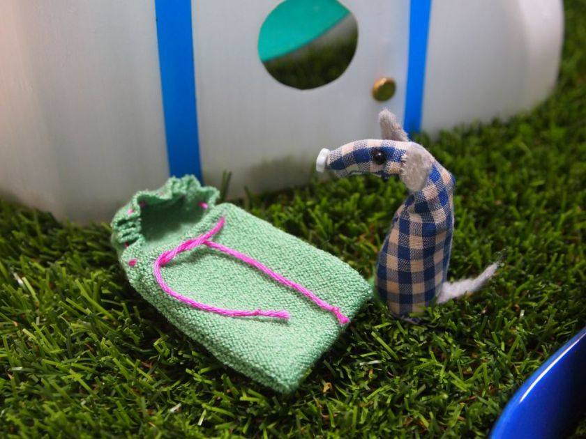 Microvaark has a tiny sleeping bag, outside the pod made from a milk bottle