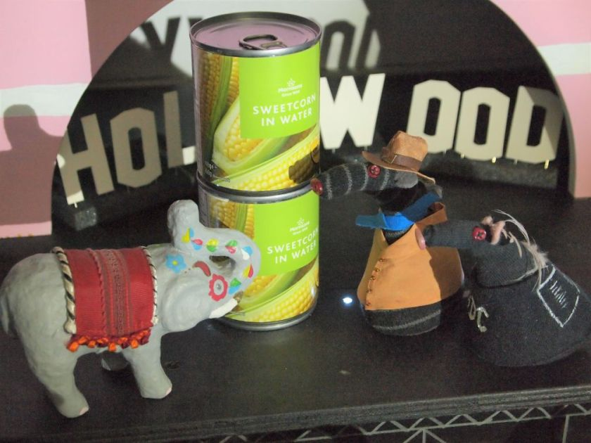 Bernard and Fury compare the stack of cans to a model elephant