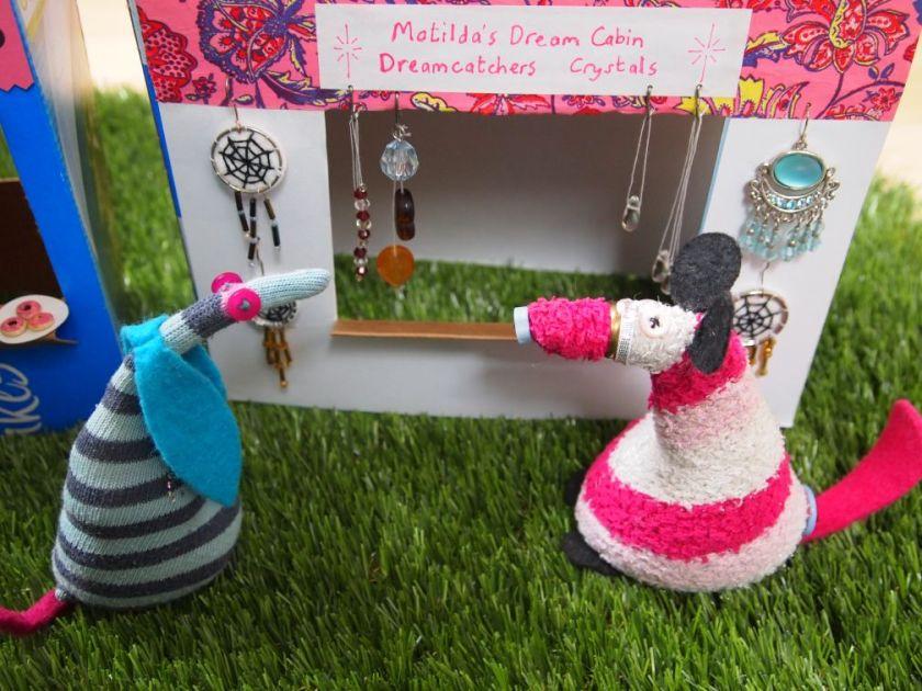 Ofelia talks to Matilda at her stall