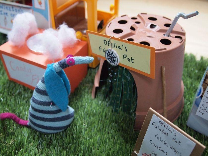 Ofelia admires the dreamcatcher hanging over the door of her stall.