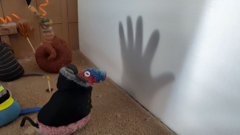 Ratvaark looks at the shadow of a creepy hand