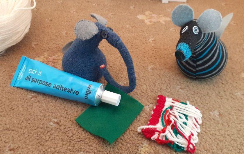 Ernest applies glue to a piece of felt.