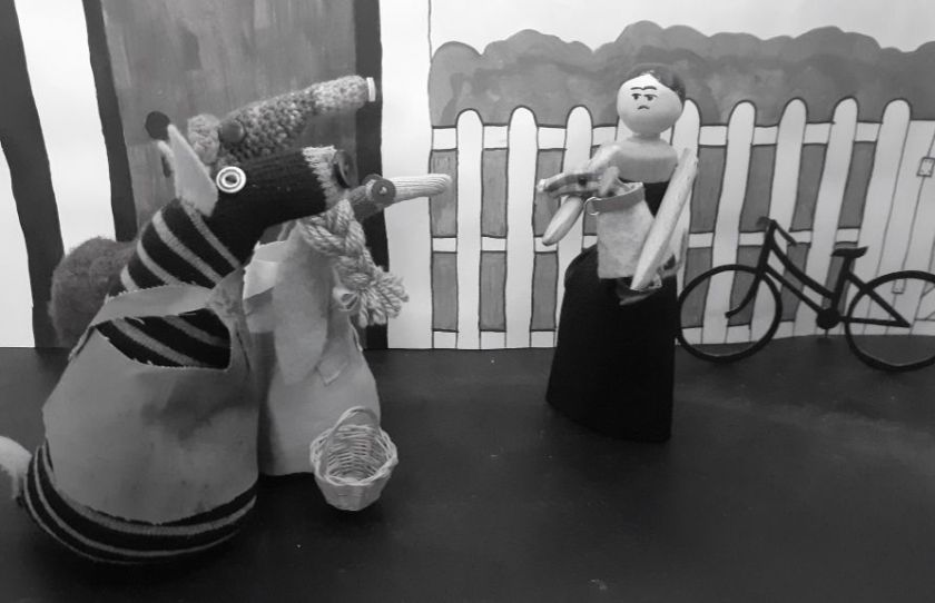 miss gulch comes back and picks toto up as aunt Em, uncle henry and dorothy beg her to stop