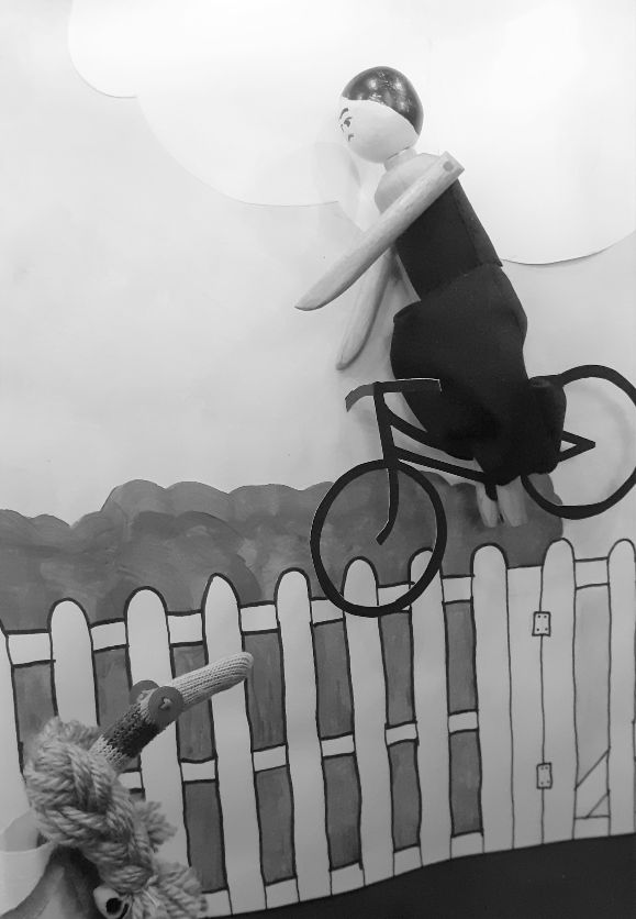 Miss gulch flies through the air on her bicycle