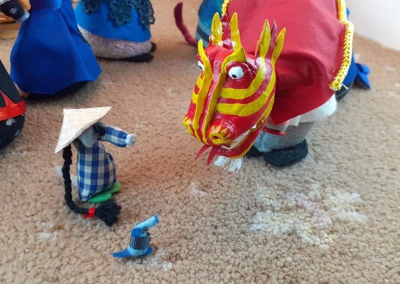 Nano looks up to the head of the dragon